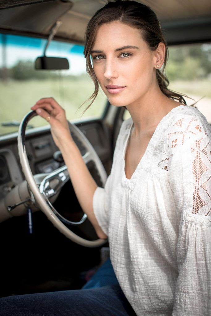 Woman Driving Classic Pickup Truck For Western Fashion Shoot with Wrangler