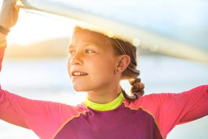 Young Girl Surfing In The Ocean. Lifestyle Surf Image