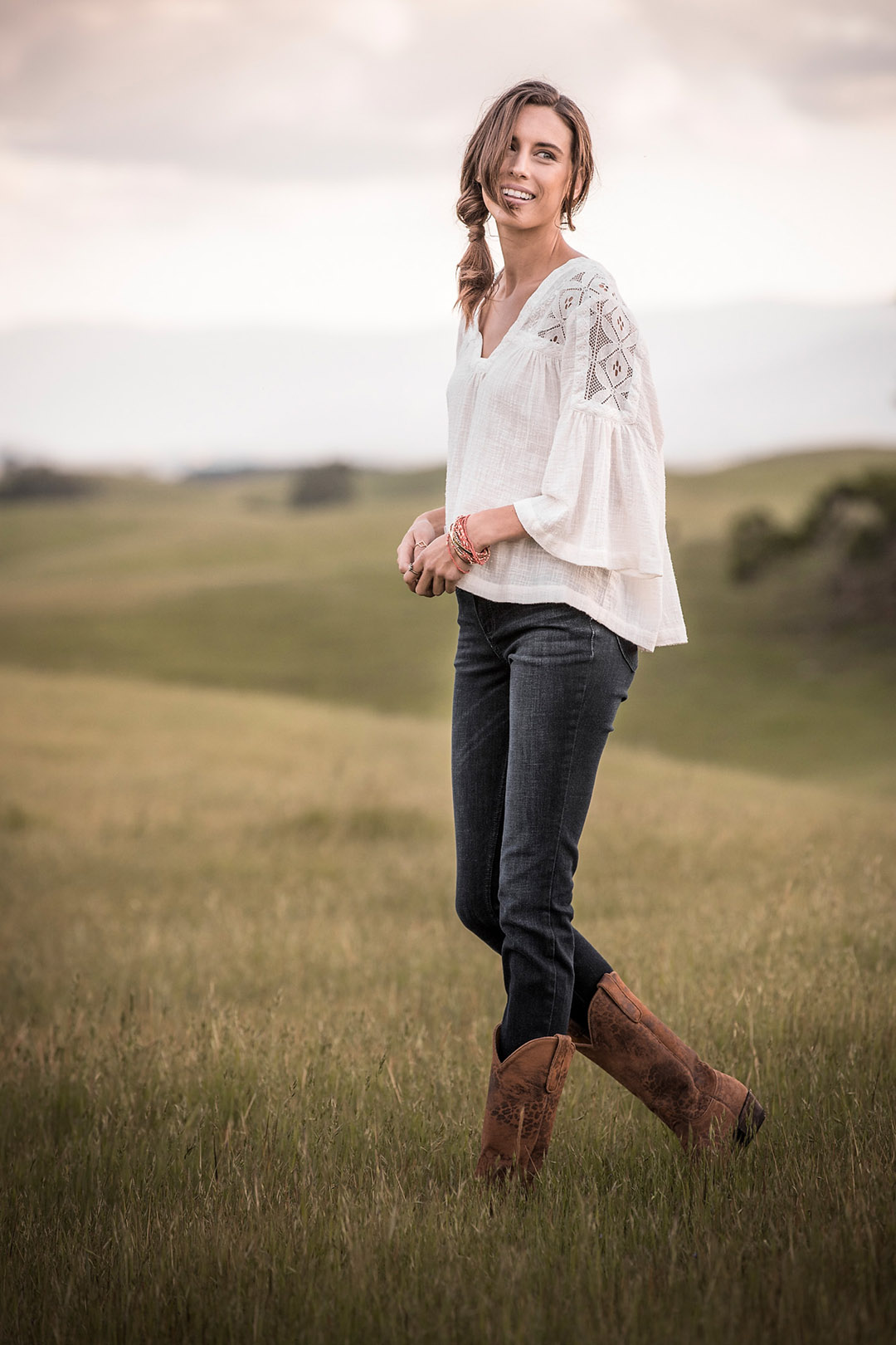 Western Lifestyle And Western Fashion Image Of A Woman On A Ranch At Sunset With Western Clothing.