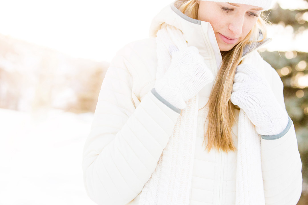Woman In The Snow In Colorado Wearing Smartwool Jacket For Lifestyle Shoot