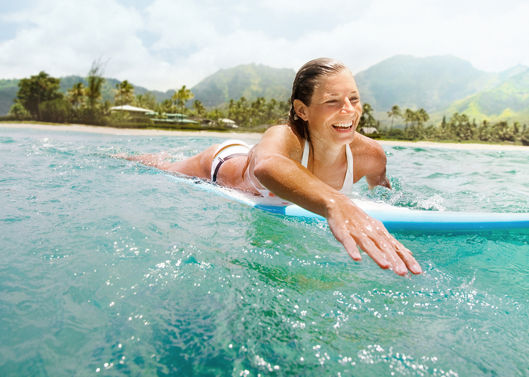Woman Female Athlete Surfing In Hawaii