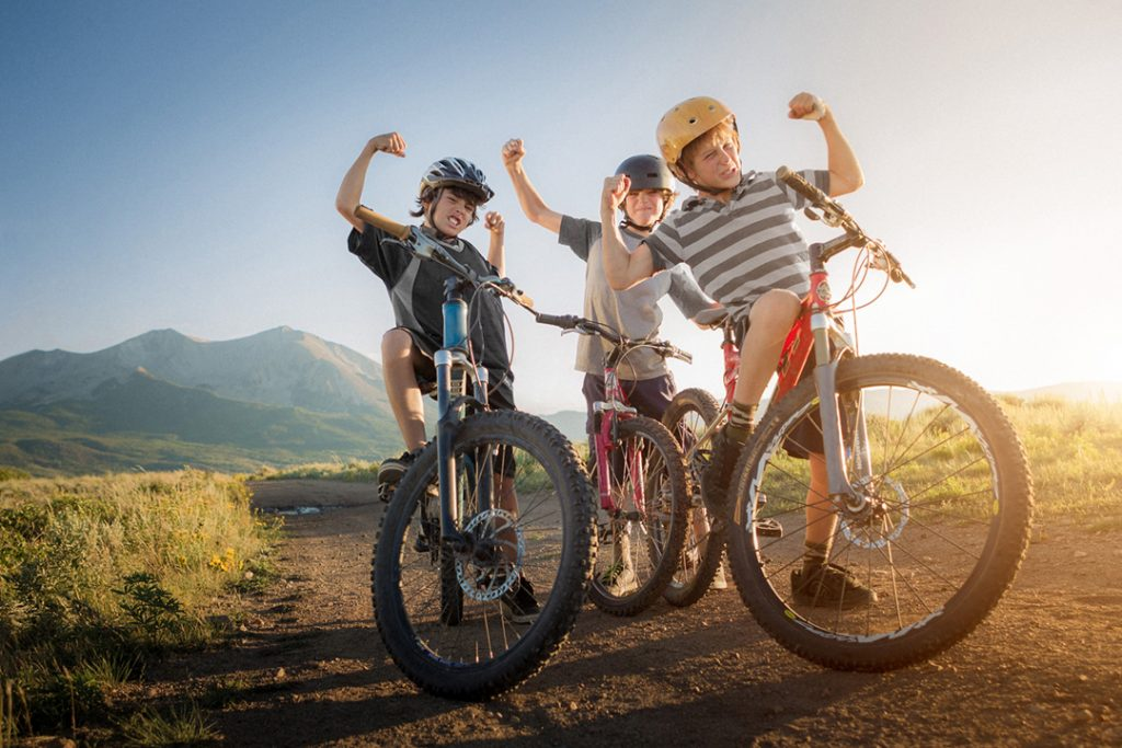 Three Boys are Proud and Excited about their Mountain Biking run Near Carbondale, Colorado. This Photo was Part of an Ad Campaign for Smartwool.