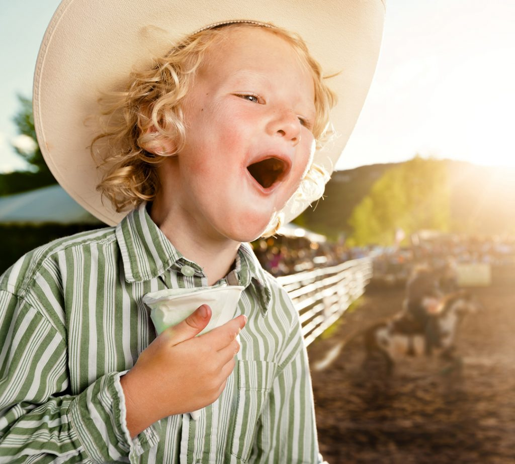 In this Image, the Youngest Rodeo Fan Shouts Encouragement to Bronc Riders at the Snowmass Rodeo. Rodeo is a True Part of Western Life for All Ages.