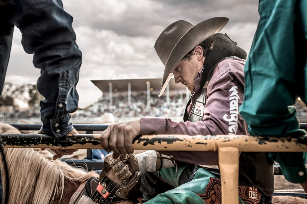 Wrangler Athlete And Saddle Bronc Rider In The Chute At A Western Rodeo In California. Shot As A Lifestyle Campaign For Wrangler Jeans.