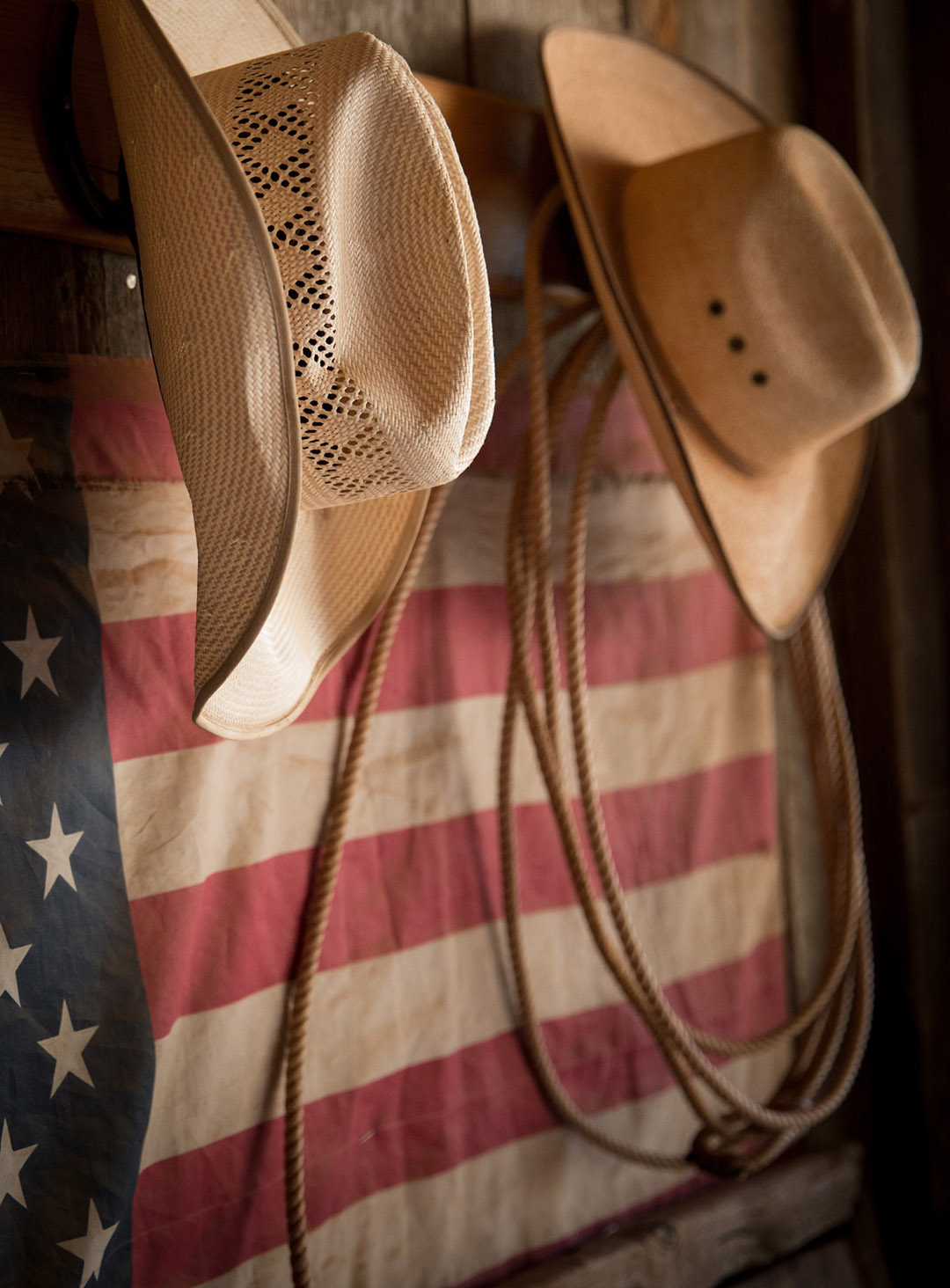 Cowboy Hats Hang By American Flag