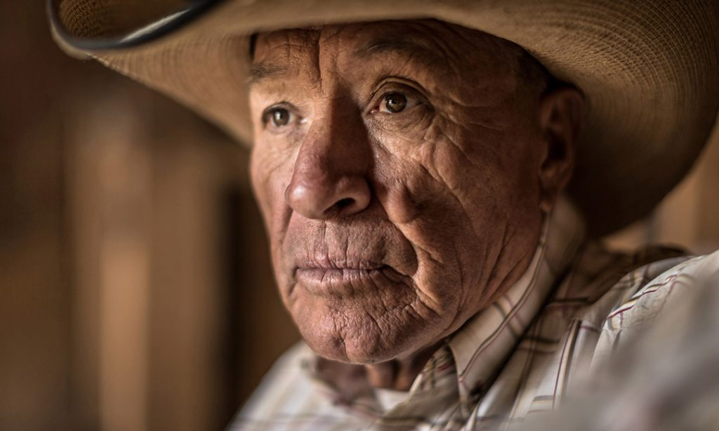 An Old Rancher Looks Out The Window.
