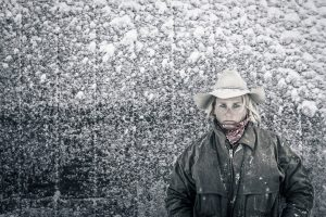Female Rancher In The Snow On A Cold Day