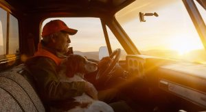 This Poignant Image Captures the Satisfaction of a Lifelong Hunter Returning from a Trip at Sunset with His Dog.