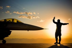 Photographs like this with a dramatic background and subjects in silhouette are powerful images of the American armed forces.