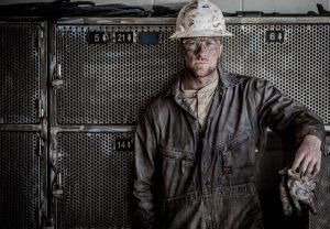 Modern American Industry Worker On Break In Industrial Job Site