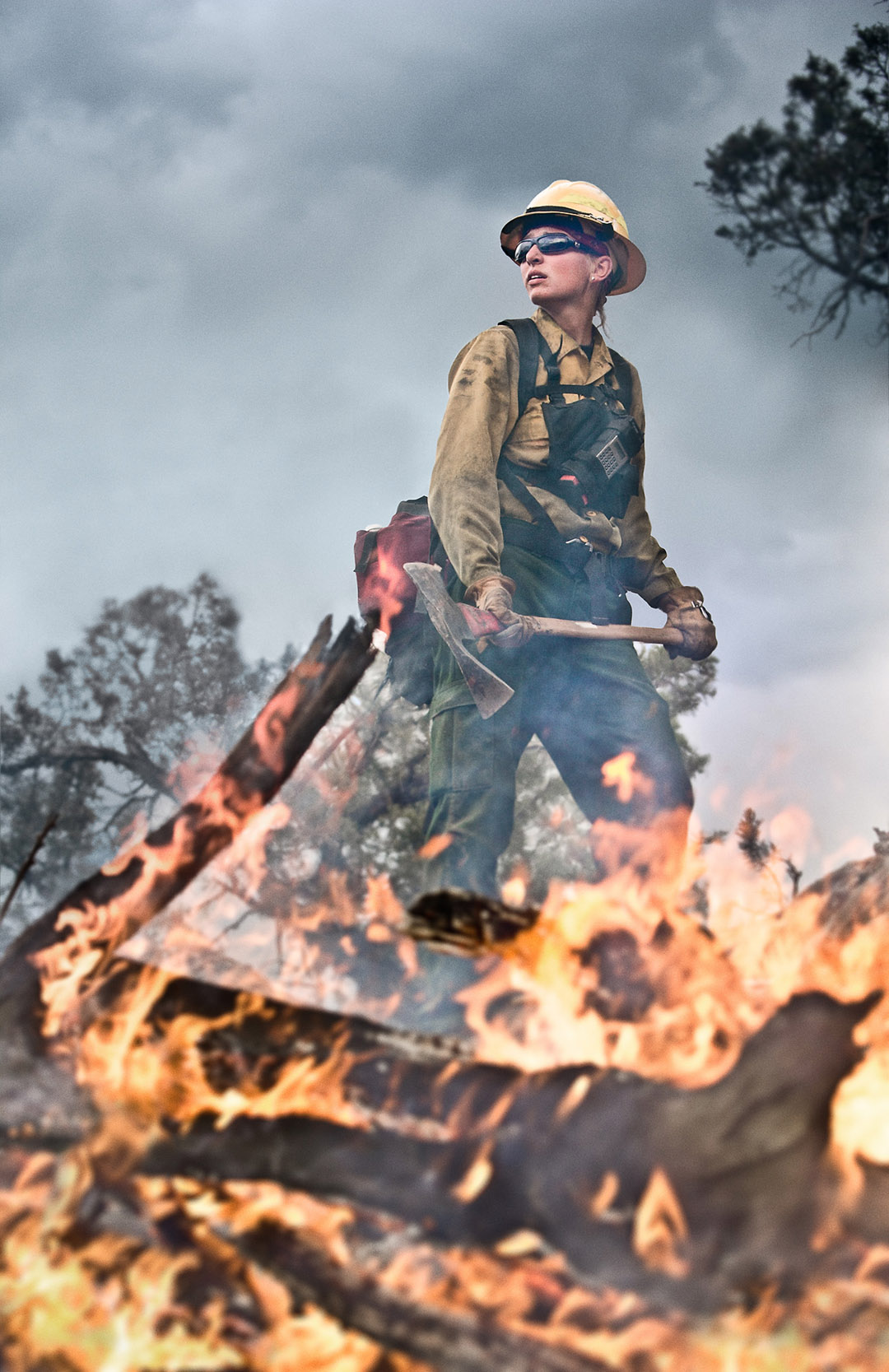 This Powerful Image Shows a Young Firefighter Digging a Trench Near a Wildfire in the Mountains of Colorado.