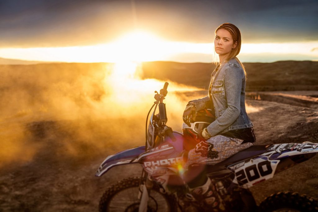 This image of a female extreme athlete sitting on her dirt bike is part of a photo series about athletes and outdoor adventurers.