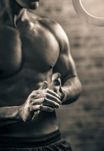 Fitness Lifestyle Director and Photographer Took this Pic of a Man Preparing for Cross-fit Games. The Intensity of this Sport is Visible in the Contrast of this Photograph.