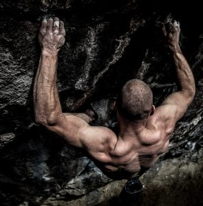 Extreme Rock Climber Climbs A Difficult Pitch In Colorado. Bouldering and Free Solo Images.