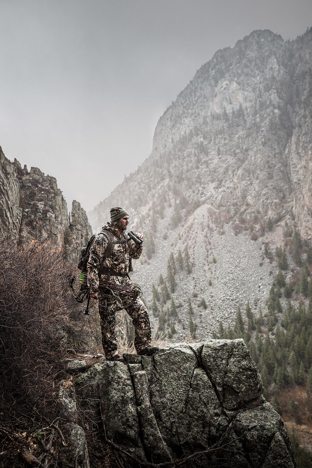 This Photograph Captures a Hunter Scouting an Elk Herd from a High Rocky Perch. In the White River National Forest, Huge Elk Herds Gather Near the Rivers.