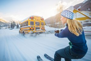Woman Skiing Behind A Bus In Silverton For Smartwool.