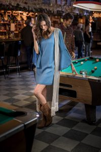 Woman in bar on a pool table for Wrangler Jeans