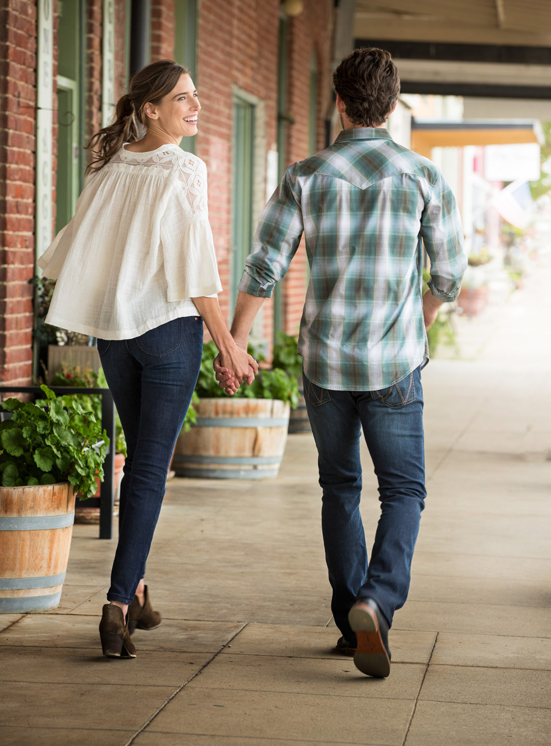 Young Couple Walks Through Town For Wrangler Jeans