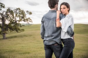 A Couple Stands In A Field During Sunset For Wrangler Jeans Campaign.