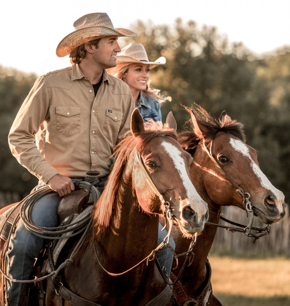 Stetson Vest and His Wife Ride Horses Through The California Sunset Cowboys On Horseback During Sunset