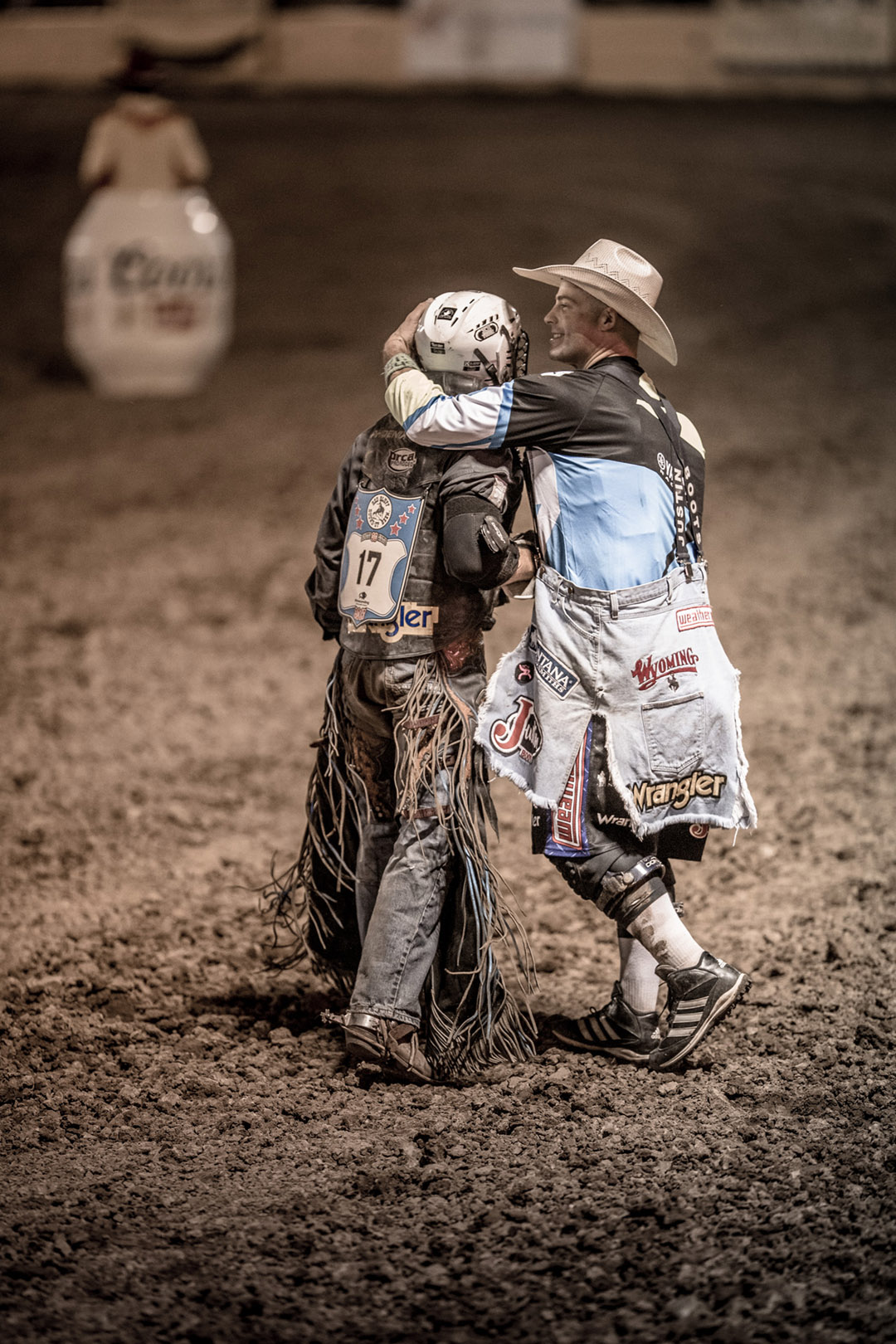 Rodeo Clown and Rodeo Athlete After Ride For Wrangler