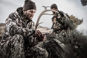 a hunter cleans an elk he shot with his bow during elk season in the high alpine.