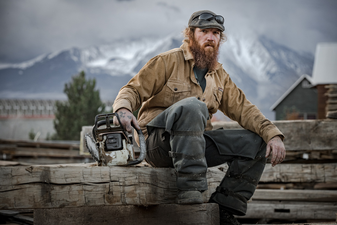 A Worker Takes A Break At A Sawmill Lumber Yard Making Reclaimed Wood Beams For Companies Such As Whole Foods. This Image Was Shot For A Patagonia Workwear Campaign.