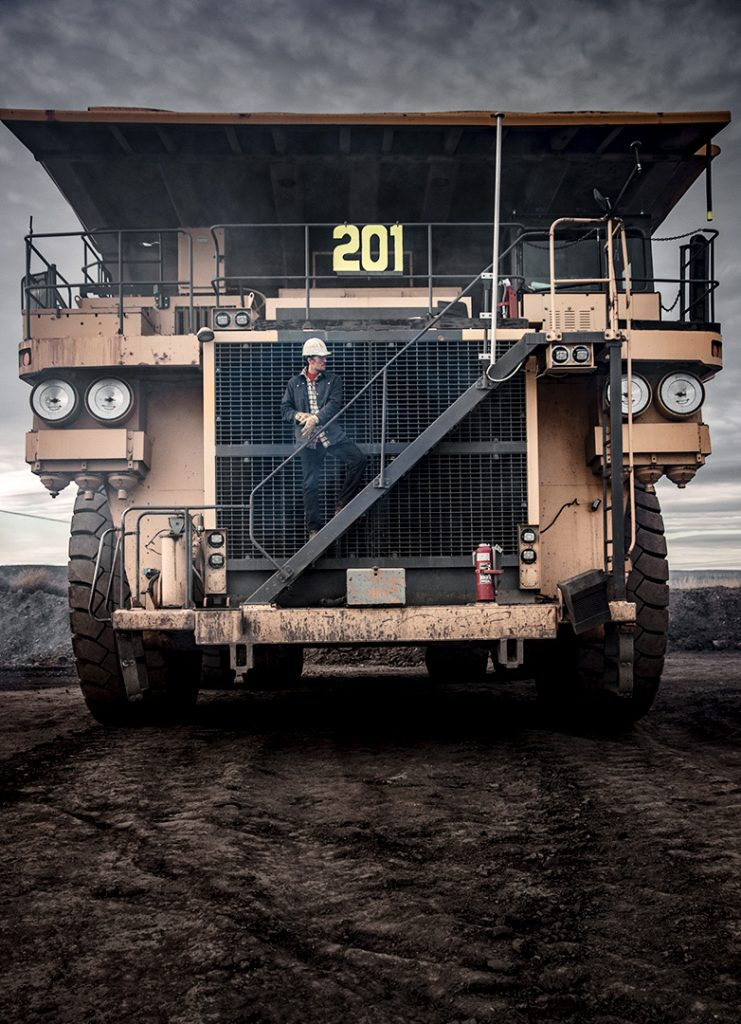 heavy industry worker on large dump truck earthmover