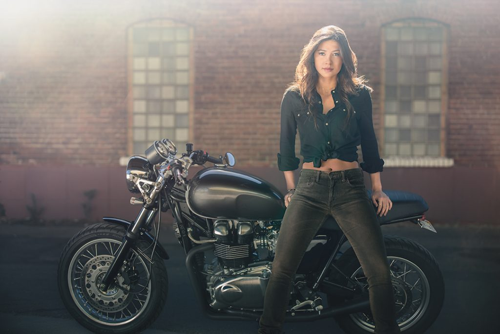 Female model on vintage motorcycle for high end fashion shoot with EOS R camera