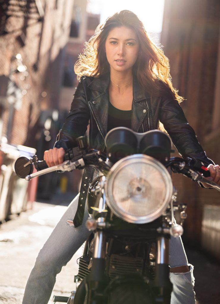 Sexy model on vintage motorcycle in urban setting for high end fashion shoot with EOS R camera