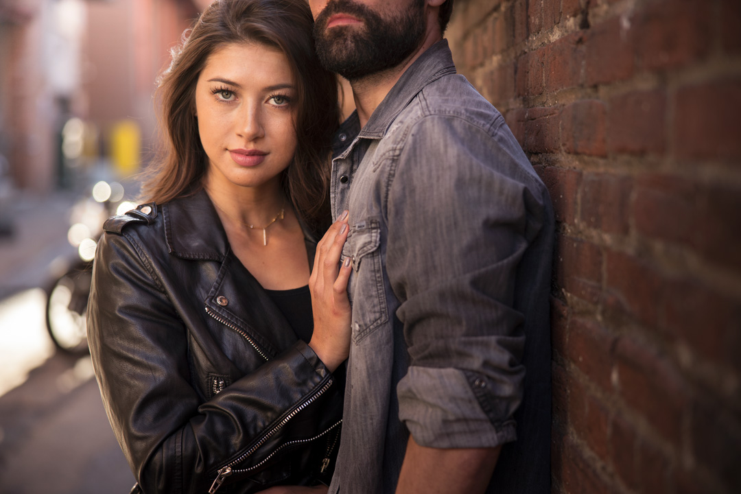 Sexy couple in urban scene for motorcycle fashion shoot in Denver Colorado.