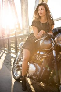 Sexy female model on vintage motorcycle for high end fashion shoot with Canon EOS R camera.