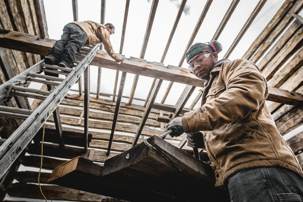 Workers at Distinguished Boards and Beams reclaim an old 1088s barn in Carbondale, Colorado