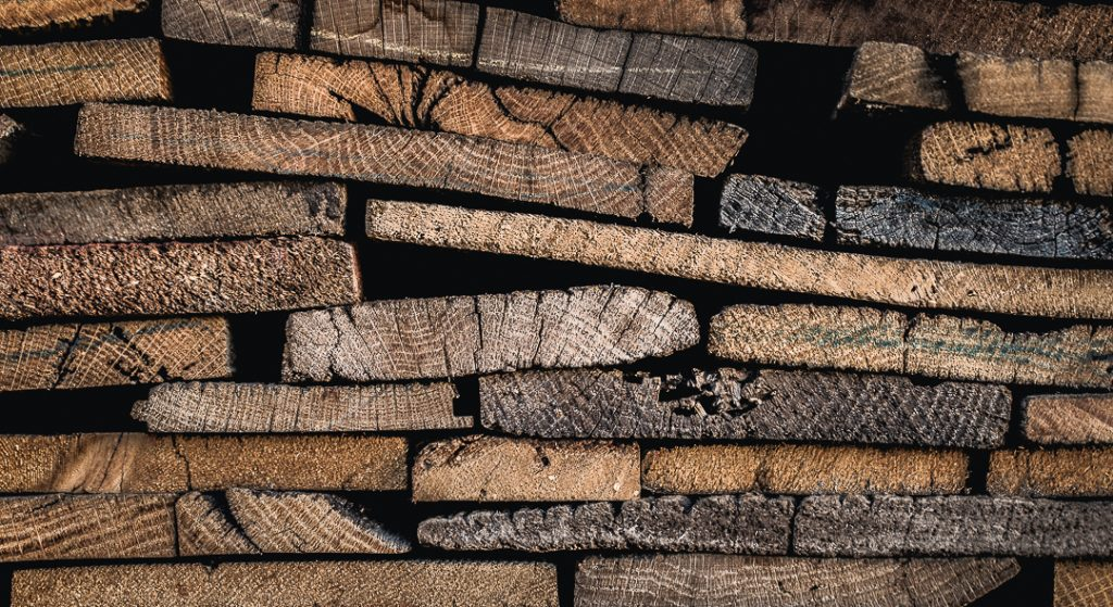 reclaimed wood lies in the yard of a shop waiting to be transformed into POS displays for Patagonia
