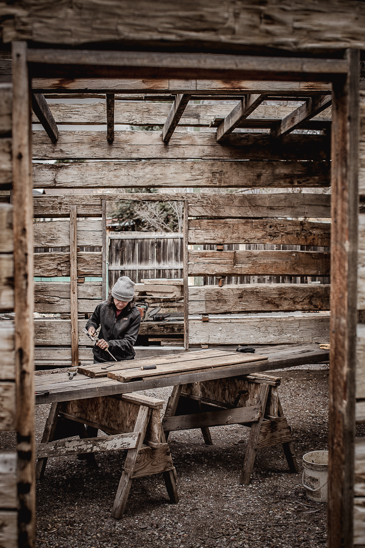 female mill worker at reclaimed timber mill in Colorado which supplies stores such as Patagonia.
