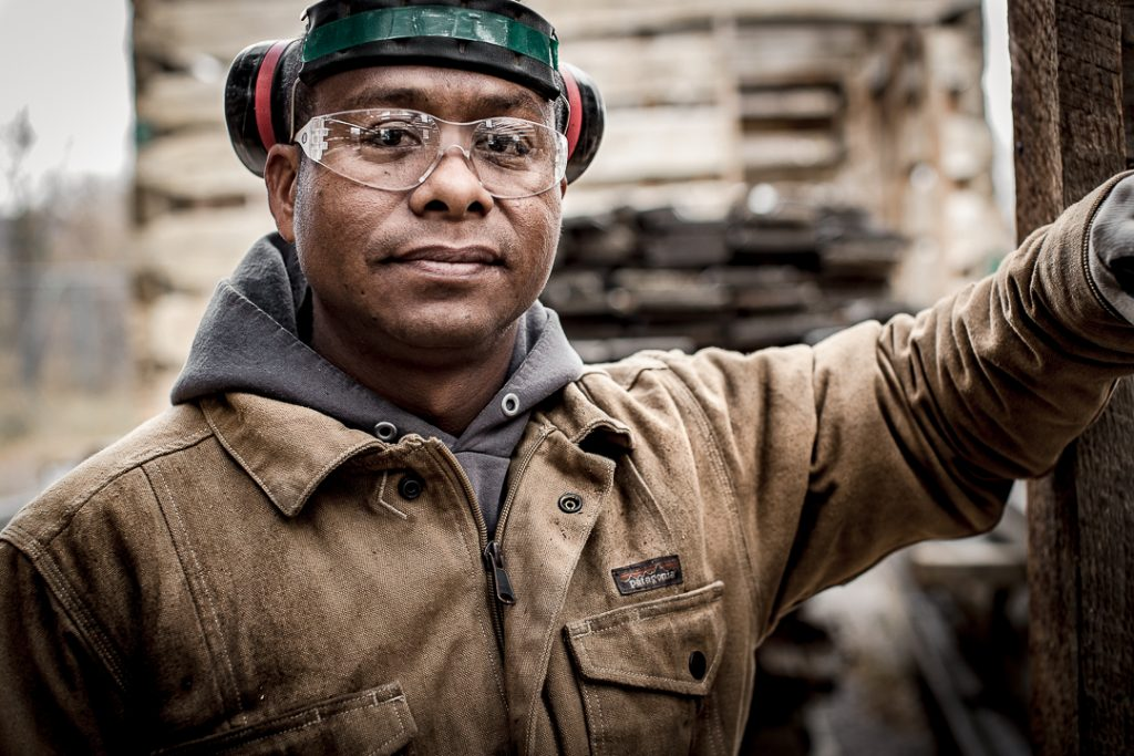 Portrait of mill worker at reclaimed wood mill.
