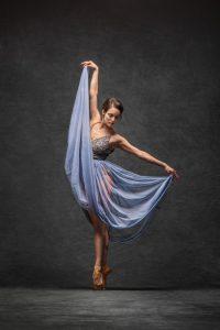 Ballet dancer in flowing purple dress.