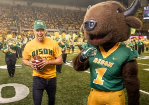 Josh Duhamel on the field with the North Dakota State football team.