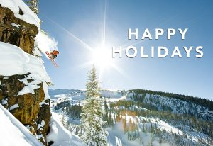 Happy Holidays | A skier leaps from a snowy cliff in Snowmass, CO.