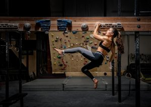 Olympic climber Brooke Raboutou hangs from a grip board at Mesa Rim Climbing Academy.