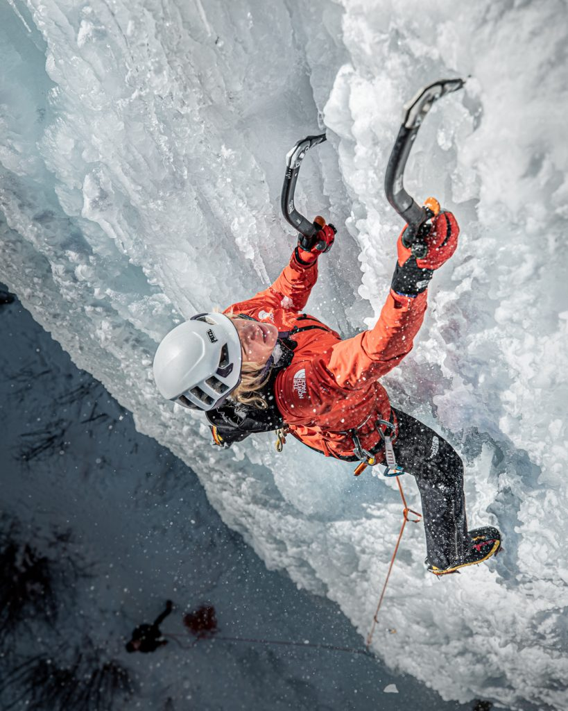 Climber Anna Pfaff ice climbing in Colorado