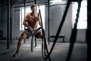 Athlete Chad Pinther works out in his Denver gym.