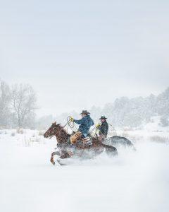 Colorado Cowboys on Horseback in a Snow Storm